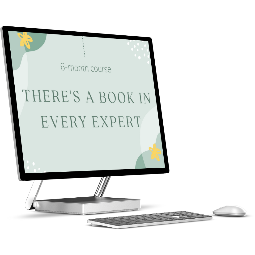 Computer monitor mockup with keyboard and mouse. Screen reads '6-month course: There's a Book in Every Expert!'